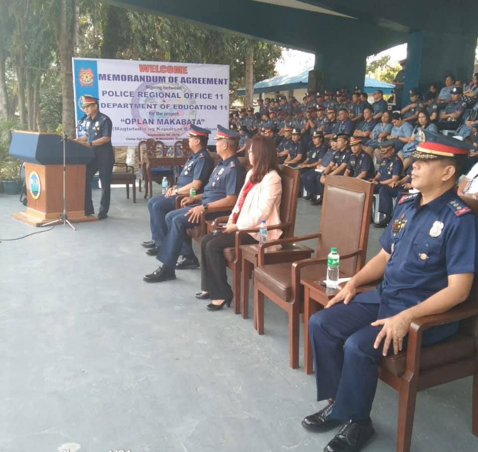 "Video: Monday Flag Raising Ceremony with GOHS, Dr.Evelyn R. Fetavero, OIC DepEd. Said visits paves way to a MOA Singning between PRO11 and DepEd on the project ""OPLAN MAKABATA"" (Magtutudlo ug Kapulisan Bata Tudluan)"